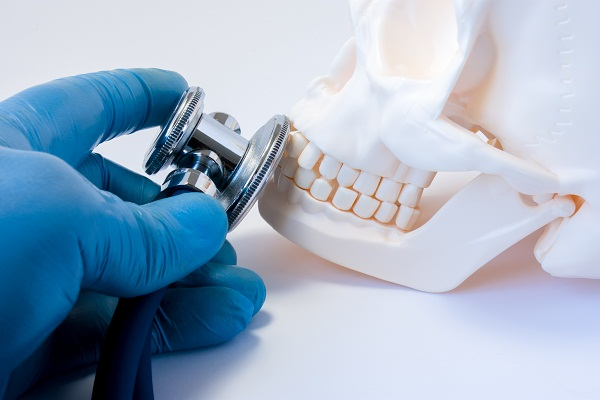 causes and treatment for supernumerary teeth